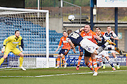 Millwall defender Mark Beevers heads at goal under pressure from Blackpool defender Tom Aldred during the Sky Bet League 1 match between Millwall and Blackpool at The Den, London, England on 5 March 2016. Photo by David Charbit.