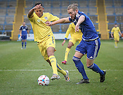 Adam Smith (Guiseley) is pushed off the ball by Kingsley James (Halifax) during the Conference Premier League match between FC Halifax Town and Guiseley at the Shay, Halifax, United Kingdom on 5 December 2015. Photo by Mark P Doherty.