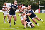 Bradford Bulls second row James Bentley (20) is tackled  during the Kingstone Press Championship match between Swinton Lions and Bradford Bulls at the Willows, Salford, United Kingdom on 20 August 2017. Photo by Simon Davies.