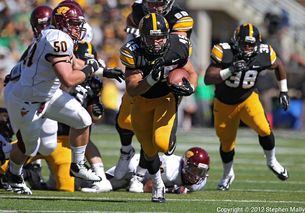 September 22 2012: Iowa Hawkeyes fullback Mark Weisman (45) runs 34 yards for a touchdown during the first half of the NCAA football game between the Central Michigan Chippewas and the Iowa Hawkeyes at Kinnick Stadium in Iowa City, Iowa on Saturday September 22, 2012. Central Michigan defeated Iowa 32-31.