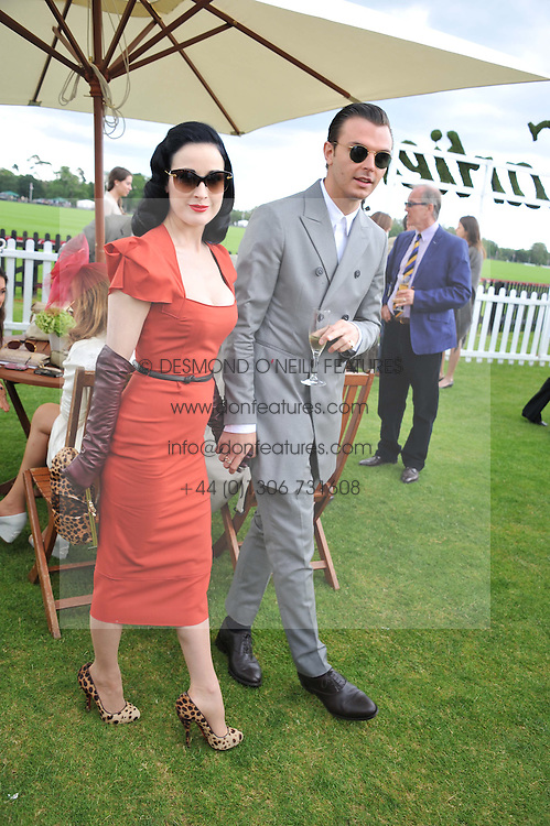 DITA VON TEESE and THEO HUTCHCRAFT at the Cartier Queen's Cup Polo Final, Guards Polo Club, Windsor Great Park, Berkshire, on 17th June 2012.
