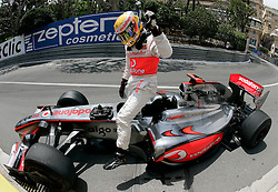 MONTE-CARLO, MONACO - Saturday, May 23, 2009: Lewis Hamilton (GBR McLaren) climbs out of his car after crashing at Mirabeau Haute during qualifying for the Monaco Formula One Grand Prix at the Monte-Carlo Circuit. (Pic by Juergen Tap/Hoch Zwei/Propaganda)