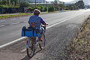Woman on bicycle, near Pollenca, Mallorca. © Dave Walsh 2012. Editorial Use only.