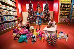 © Licensed to London News Pictures. 27/06/2013. London, UK. Lottie, 5, (L), Beau, 5, (C) and Jayla, 3, are seen amongst some of Hamleys predicted top toys for Christmas 2013 at the Christmas in June press event at Hamleys toy shop in London today (27/06/2013).  Held in retailers world famous Regents Street store, the event showcases the predicted top toys for Christmas 2013. Photo credit: Matt Cetti-Roberts/LNP