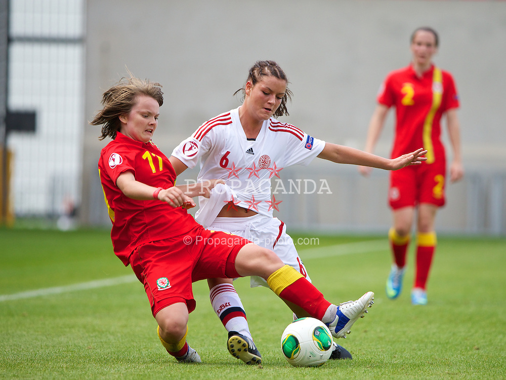 LLANELLI, WALES - Monday, August 19, 2013: Wales' Ellie Curson in action against Denmark's Anna Fisker during the opening Group A match of the UEFA Women's Under-19 Championship Wales 2013 tournament at Parc y Scarlets. (Pic by David Rawcliffe/Propaganda)