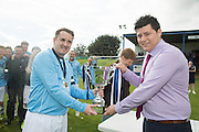 Dundee captain Scott Peters receives the trophy from sponsor Stepeh Tosh of the Maltman Bar - Dundee v Dundee United - fans charity derby at Thomson Park, Lochee in aid Cancer Research UK<br /> <br />  - &copy; David Young - www.davidyoungphoto.co.uk - email: davidyoungphoto@gmail.com