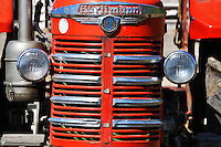 Switzerland. Springtime. Close-up of the front of an old, red Hürlimann tractor.