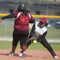 Tohatchi Cougar Sierra Peterson (32) misses the ball and Rehoboth Lynx safety returns to second base during the game in Gallup Tuesday.