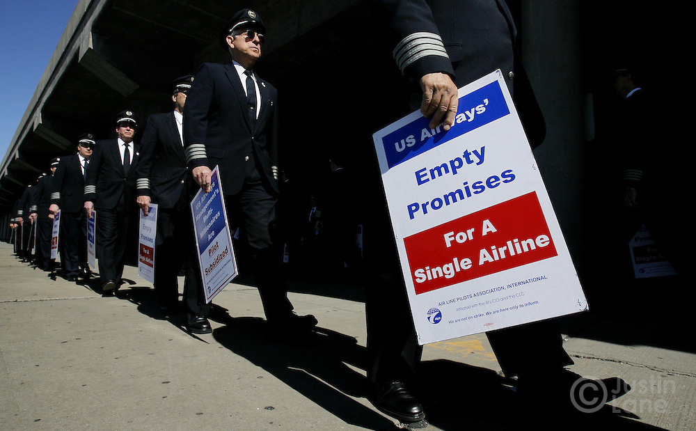 A group of US Airways pilots picket to protest the tactics being used by US Airways in the ongoing contract negotiations in front of the US Airways terminal at LaGuardia Airport in Queens, New York on Thursday 29 March 2007. Negotiations for a single pilot contract have been going on for a year and a half.