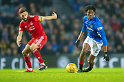 Oviemuno Ejaria (#10) of Rangers FC breaks away from Graeme Shinnie (#3) of Aberdeen FC during the Ladbrokes Scottish Premiership match between Rangers and Aberdeen at Ibrox, Glasgow, Scotland on 5 December 2018.