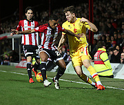 Milton Keynes Dons striker Sam Gallagher battling for the ball with Brentford defender Nico Yennaris during the Sky Bet Championship match between Brentford and Milton Keynes Dons at Griffin Park, London, England on 5 December 2015. Photo by Matthew Redman.