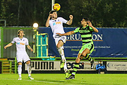 Swansea City's Cian Harris heads the ball clear under pressure from Forest Green Rovers Omar Bugiel(11) during the EFL Trophy match between Forest Green Rovers and U21 Swansea City at the New Lawn, Forest Green, United Kingdom on 31 October 2017. Photo by Shane Healey.