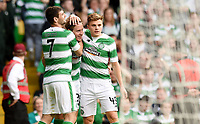 15/07/15 UEFA CHAMPIONS LEAGUE QUALIFIER<br /> CELTIC V STJARNAN<br /> CELTIC PARK - GLASGOW<br /> Celtic ace Stefan Johansen (centre) celebrates his goal with team-mates Nadir Ciftci (left) and James Forrest.