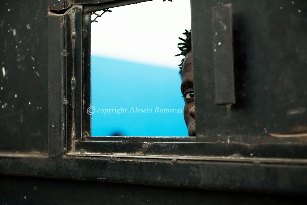 Libya, Zawyia: A migrant is seen inside his cell in Al Nasr detention center for migrants in Zawyia. Alessio Romenzi