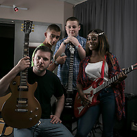 &copy;Andrew Baker.<br /> LONDON.UK. 24th June 2014 <br /> Performer/Actor Ben Drew with a group of students in the newly refurbished music room funded solely by Ben, known as Plan B, who was a former student at the centre, which has ben named after Ben's former music teacher Cliff Earlye.<br /> Photo Credit  Andrew Baker.