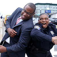 (Boston, MA - 11/5/17) Boston City Councilor and mayoral candidate Tito Jackson jokes around with a police officer in Mattapan, Sunday, November 5, 2017. Staff photo by Angela Rowlings.