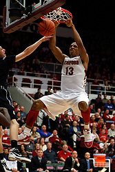 Dec 22, 2011; Stanford CA, USA;  Stanford Cardinal forward/center Josh Owens (13) dunks against the Butler Bulldogs during the first half at Maples Pavilion.  Mandatory Credit: Jason O. Watson-US PRESSWIRE