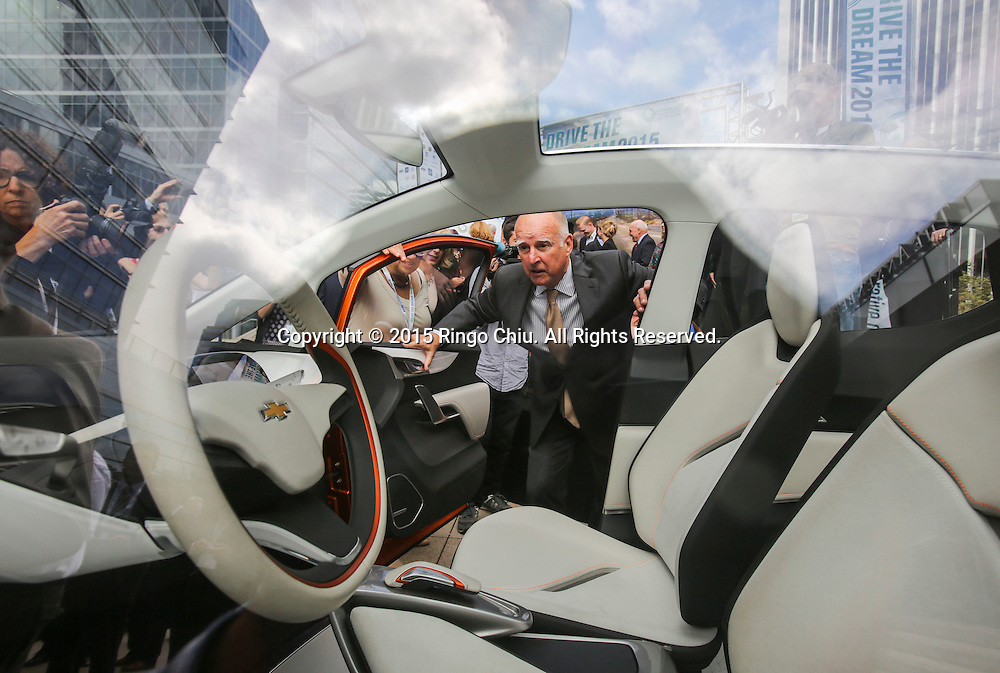 California Gov. Jerry Brown takes a closer look at the Chevrolet Bolt EV concept car in Drive the Dream 2015 event at Creative Artists Agency in Los Angeles October 15, 2015.  (Photo by Ringo Chiu/PHOTOFORMULA.com)