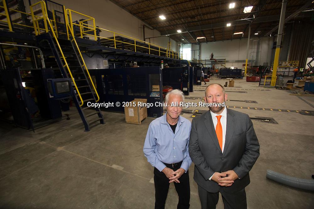 David Weissberg, right, CEO of Acorn Paper Products Co., and Dennis Mehiel of  Acorn Paper Products Co.. <br /> Photo by Ringo Chiu/PHOTOFORMULA.com)