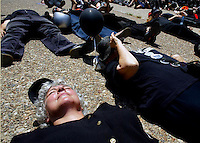 Gila Svirsky, co-founder of the Coalition of Women 4 Peace in Israel and an original member of the Women in Black, lies on the ground to protest Israel's occupation of Palestinian territory.