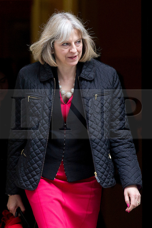 © Licensed to London News Pictures. 18/03/2014. London, UK. The Home Secretary, Theresa May, leaves a meeting of the British cabinet on Downing Street in London today (18/03/2014). Photo credit: Matt Cetti-Roberts/LNP