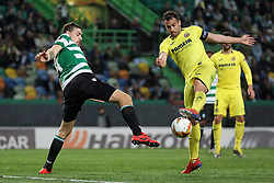 February 14, 2019 - Lisbon, Portugal - Sebastián Coates of Sporting CP (L) vies for the ball with Mario Gaspar of Villarreal FC (R) during the Europa League 2018/2019 footballl match between Sporting CP vs Villarreal FC. (Credit Image: © David Martins/SOPA Images via ZUMA Wire)
