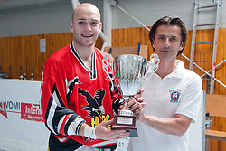 Bernard Urbanija, President of IZS, and Domen Vedlin,  HK Prevoje, with trophy for first place at final match of IZS Masters 2011 inline hockey between Troha Pub Bled and HK Prevoje, on June 4, 2011 in Sportni park, Horjul, Slovenia. (Photo by Matic Klansek Velej / Sportida)