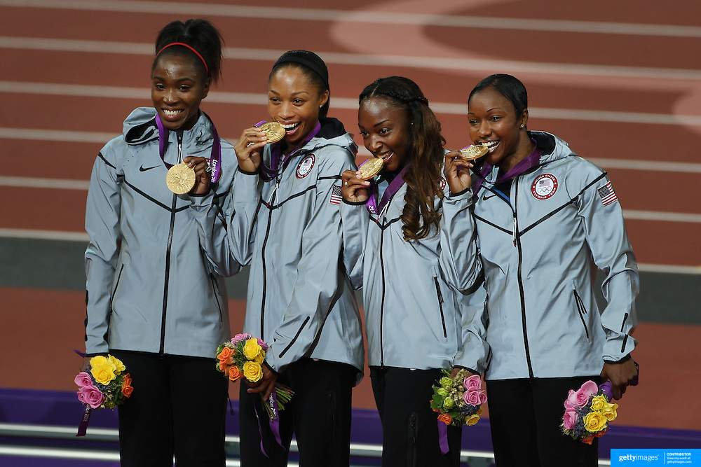 The USA Women's 4 x 100 relay team of Tianna Madison, Allyson Felix, Bianca Knight and Carmelita Jeter at the Gold Medal presentation at the Olympic Stadium, Olympic Park, during the London 2012 Olympic games. London, UK. 10th August 2012. Photo Tim Clayton