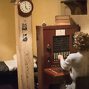 Manequin of a telephone switchboard operator at the Churchill War Rooms in London. The museum, one of five branches of the Imerial War Museums, preserves the World War II underground command bunker used by British Prime Minister Winston Churchill. Its cramped quarters were constructed from a converting a storage basement in the Treasury Building in Whitehall, London. Being underground, and under an unusually sturdy building, the Cabinet War Rooms were afforded some protection from the bombs falling above during the Blitz.