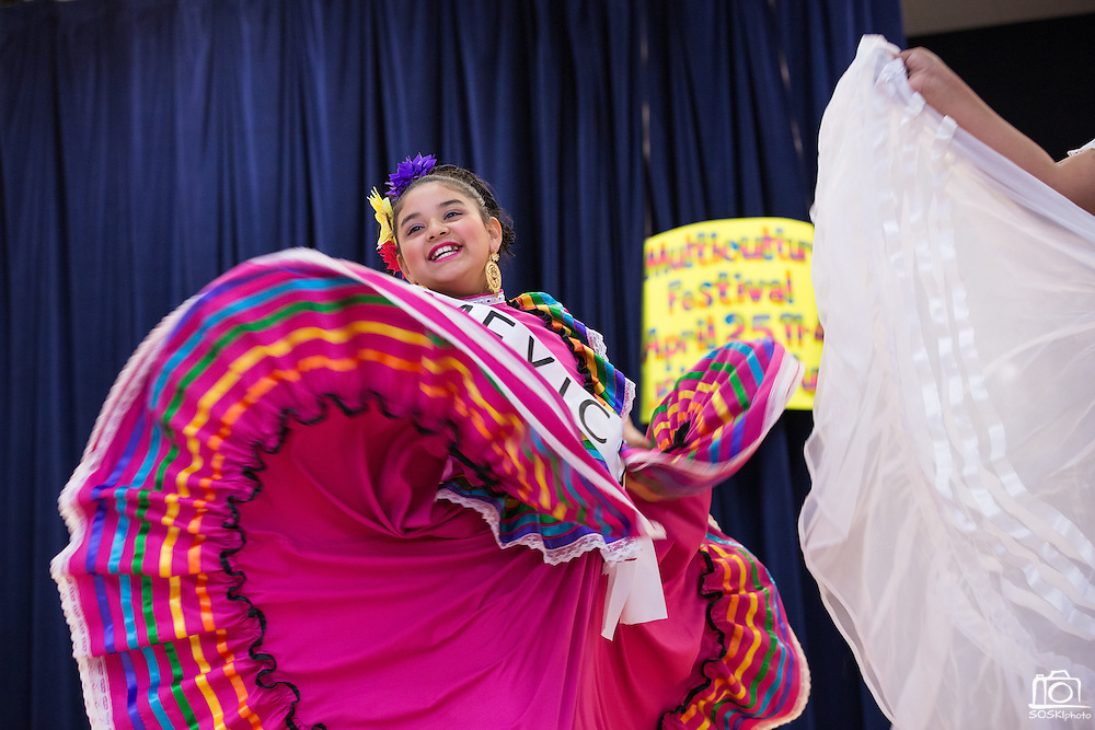 Dressed in traditional attire from Mexico, 5th grader Jocelyn Rodriguez performs in a fashion show during the Pomeroy Multicultural Festival at Pomeroy Elementary School in Milpitas, California, on April 25, 2015. (Stan Olszewski/SOSKIphoto)