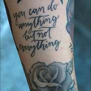 Tattoo Quote &quot;you can do anything but not everything&quot; on her arm.<br /> <br /> Tattoos are no longer just a male thing, young women are just as likely to get a tattoo as males. <br /> <br /> Body art or tattoos has entered the mainstream it is no longer considered a weird kind of subculture.<br /> <br /> &quot;According to a 2006 Pew survey, 40% of Americans between the ages of 26 and 40 have been tattooed&quot;.
