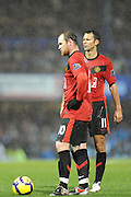 Wayne Rooney (L-Manchester United) and Ryan Giggs (Manchester United) and discuss tactics before a free kick which Giggs scores. Portsmouth v Manchester United (1-4), Barclays Premier League Fratton Park, Portsmouth, 28th November 2009.