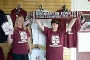 NTFC Staff pose with champions merchandise during the Sky Bet League 2 match between Northampton Town and Crawley Town at Sixfields Stadium, Northampton, England on 19 April 2016. Photo by Dennis Goodwin.