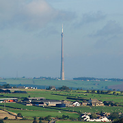 The Emley Moor TV mast standing out against the rural farming area of the Yorkshire Pennines in Britain.