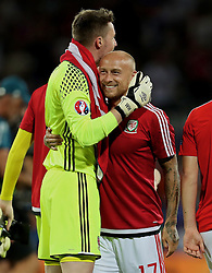 TOULOUSE, FRANCE - Monday, June 20, 2016: Wales' goalkeeper Wayne Hennessey and David Cotterill celebrate at the final whistle after beating Russia 3-0 and qualifying for the knock-out stage during the final Group B UEFA Euro 2016 Championship match at Stadium de Toulouse. (Pic by David Rawcliffe/Propaganda)