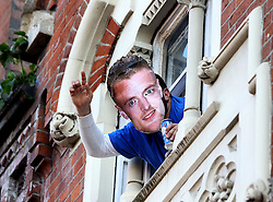 A Leicester City supporter wearing a Jamie Vardy mask leans out of a window for the open top parade - Mandatory by-line: Robbie Stephenson/JMP - 16/05/2016 - FOOTBALL - Leicester City FC, Barclays Premier League Winners 2016 - Leicester City Victory Parade