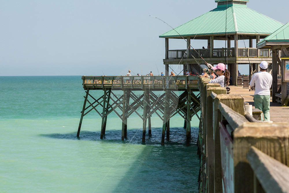 People fish from Folly Beach Pier May 12, 2014 in Folly Beach, Charleston, SC.