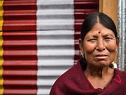 02 AUGUST 2015 - BHAKTAPUR, NEPAL:  A woman in a small Internal Displaced Person (IDP) camp at Durbar Square in Bhaktapur for people left homeless by the Nepal earthquake. The Nepal Earthquake on April 25, 2015, (also known as the Gorkha earthquake) killed more than 9,000 people and injured more than 23,000. It had a magnitude of 7.8. The epicenter was east of the district of Lamjung, and its hypocenter was at a depth of approximately 15 km (9.3 mi). It was the worst natural disaster to strike Nepal since the 1934 Nepal–Bihar earthquake. The earthquake triggered an avalanche on Mount Everest, killing at least 19. The earthquake also set off an avalanche in the Langtang valley, where 250 people were reported missing. Hundreds of thousands of people were made homeless with entire villages flattened across many districts of the country. Centuries-old buildings were destroyed at UNESCO World Heritage sites in the Kathmandu Valley, including some at the Kathmandu Durbar Square, the Patan Durbar Squar, the Bhaktapur Durbar Square, the Changu Narayan Temple and the Swayambhunath Stupa. Geophysicists and other experts had warned for decades that Nepal was vulnerable to a deadly earthquake, particularly because of its geology, urbanization, and architecture.      PHOTO BY JACK KURTZ