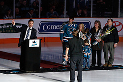 February 1, 2011; San Jose, CA, USA; San Jose Sharks general manager Doug Wilson (left) presents center Patrick Marleau (12) with a silver hockey stick to commemorate his 1000th NHL game before the game against the Phoenix Coyotes at HP Pavilion. Mandatory Credit: Jason O. Watson / US PRESSWIRE