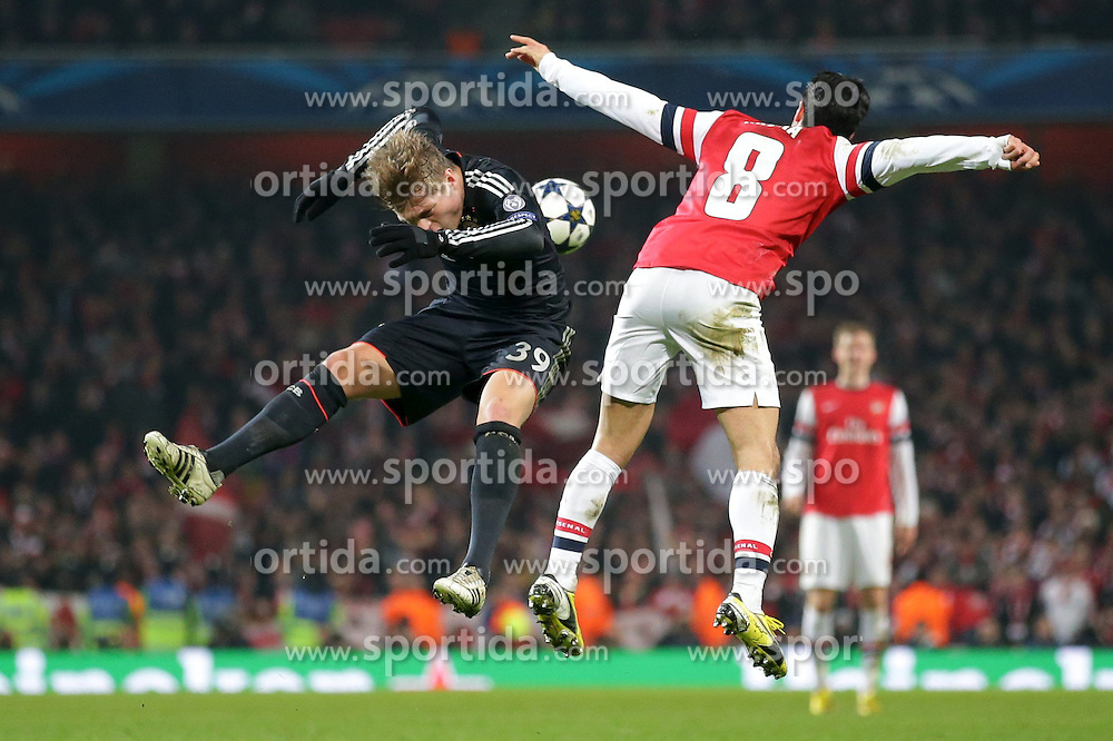 19.02.2013, Emirates Stadion, London, ENG, UEFA Champions League, FC Arsenal vs FC Bayern Muenchen, Achtelfinale Hinspiel, im Bild, Toni KROOS (FC Bayern Muenchen - 39) im Duell mit Mikel ARTETA (FC Arsenal London - 8) // during the UEFA Champions League last sixteen first leg match between Arsenal FC and FC Bayern Munich at the Emirates Stadium, London, Great Britain on 2013/02/19. EXPA Pictures © 2013, PhotoCredit: EXPA/ Eibner/ Gerry Schmit..***** ATTENTION - OUT OF GER *****
