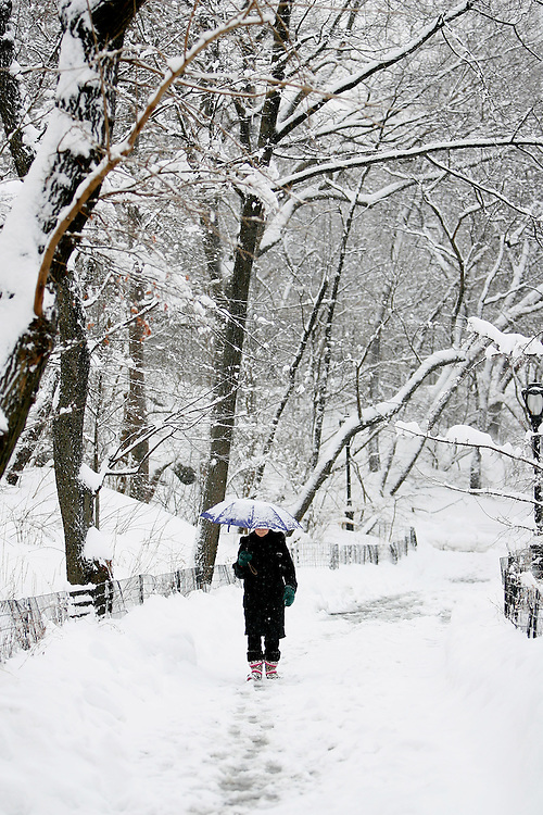 A woman walking through central park  as the region is hit with a snow storm on February 26, 2009 in New York City. photo by Joe Kohen for The New York Times