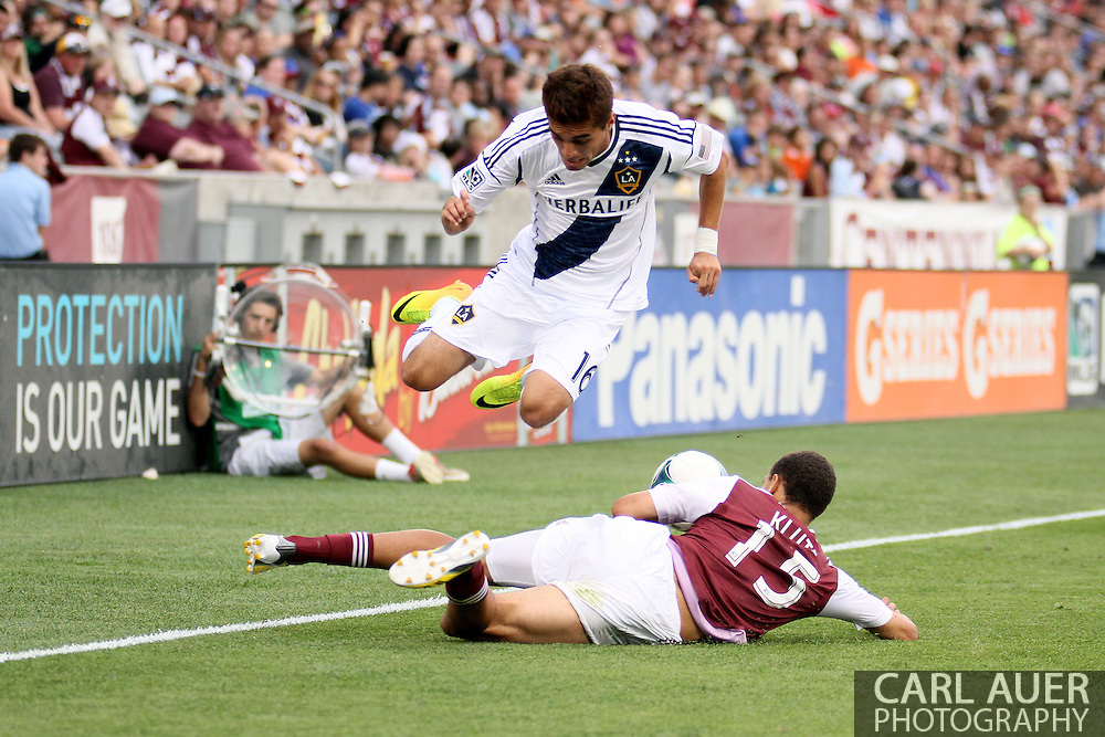 July 27th, 2013 - LA Galaxy midfielder Hector Jimenez (16) goes airborne to avoid the slide tackle by Colorado Rapids defender Chris Klute (15) in the second half of action in the Major League Soccer match between the LA Galaxy and the Colorado Rapids at Dick's Sporting Goods Park in Commerce City, CO