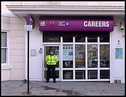 A police officer stands outside the Army Careers office in the centre of Brighton after a Bomb scare today, Thursday, 13th February 2014. Four suspect packages have been delivered to Army careers offices in the South East of England the counter-terrorism police have said today. Picture by Andrew Parsons / i-Images