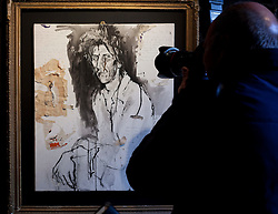 © Licensed to London News Pictures. 24/02/2012. LONDON, UK. A photographer takes a picture of  a portrait by 'Wolf Man' a friend of Pete Doherty and decorated with the singers blood, at an exhibition in Camden today (24/02/12). The exhibition entitled 'On Blood: A Portrait of an Artist', held at the Cob Gallery in Camden and set to run between the 26th of February and the 4th of March, features works and collections by the former Libertines lead singer. Photo credit: Matt Cetti-Roberts/LNP