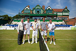 LIVERPOOL, ENGLAND - Sunday, June 22, 2014: Australian tennis legend Peter McNamara walks onto court in full cricket whites to play doubles with Marion Bartoli (FRA) against Jan-Michael Gambill and Mikael Pernfors and Tournament Referee Alan Mills during Day Four of the Liverpool Hope University International Tennis Tournament at Liverpool Cricket Club. (Pic by David Rawcliffe/Propaganda)