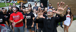 August 18, 2017 - Lake Mary, FL, USA - Lake Mary, Fla. High School students in science teacher Luther Davis' (right, bow tie) class use their eclipse glasses for the first time, during a trial run, Friday, Aug. 18, 2017, for their planned viewing of Monday's eclipse. (Credit Image: © Joe Burbank/TNS via ZUMA Wire)