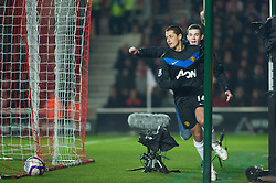 SOUTHAMPTON, ENGLAND - Saturday, January 29, 2011: Manchester United's Javier Hernandez is chased by a fan after his goal makes it 2-1 against Southampton during the FA Cup 4th Round match at St. Mary's Stadium. (Photo by Gareth Davies/Propaganda)