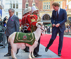 Image ©Licensed to i-Images Picture Agency. 10/06/2014. London, United Kingdom. HRH Prince Harry attends the 50th Anniversary of Zulu premiere. . Picture by Anthony Upton / i-Images<br /> Leicester Square, London, 10 June 2014: HRH Pr. Harry meets L/Cpl Shenkin, the Regimental Mascot of the 3rd Batt. The Royal Welsh on the red carpet at a gala screening to celebrate the 50th Anniversary of Zulu where guests were joined by Prince Harry to watch a digitally remastered version of the iconic film. The evening was arranged to raise money for two charities supported by Prince Harry, Walking With The Wounded and Sentebale. <br /> For further info please contact<br /> Emily Conrad-Pickle Captive Minds<br /> Mobile: +44 (0)7799 414 790<br /> emily.conrad-pickles@captiveminds.com