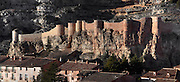 Panoramic view of the Castle, Albarracin, Teruel, Spain, on February 13, 2006, pictured in the morning. At the top of the village is the 10th century Moorish castle, reached through cobbled streets of  houses constructed of wood and plaster with small windows. Albarracin, a beautiful village with National Monument status overlooking the Guadalivar River, lies 28 km from Teruel, in the National Park in the Montes Universale. It is on the border of three Spanish Kingdoms: Castille, Aragon and Valencia, has been occupied for hundreds of years and is known as the Eagles` Nest because it is built on a steep outcrop of rock surrounded by a deep gorge, a natural defence. Its buildings show  Moorish influence and even the name may derive from  the Berber clan Banu Razin who settled in the area during the 9th century. Picture by Manuel Cohen.