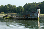 Wreck of a barge rots on the Hamble River, Hampshire, England 12/9/2008